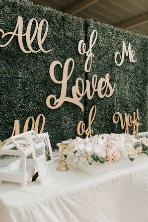 Neutral Escort Card Table With Themed Backdrop