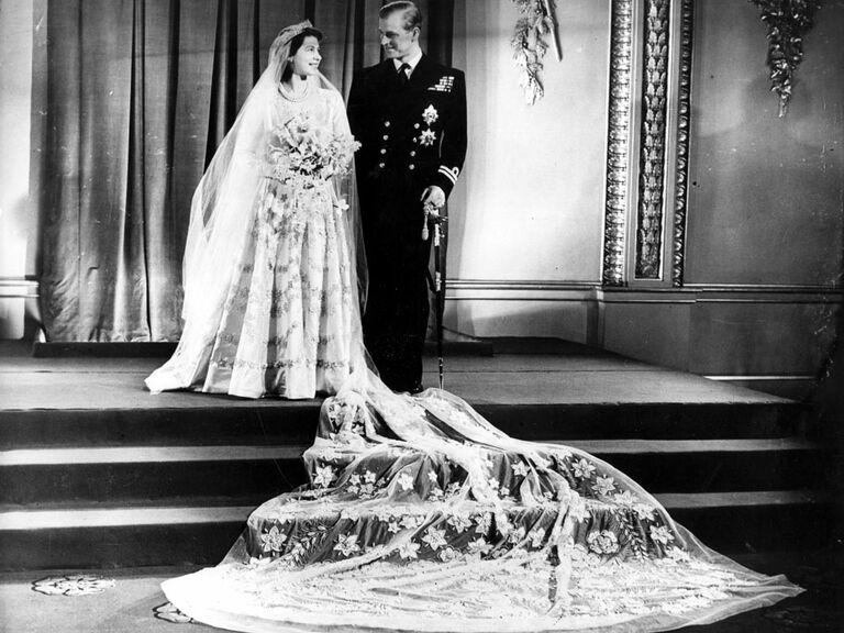 Queen Elizabeth wedding dress picture with veil laid out on wedding day with Prince Phillip