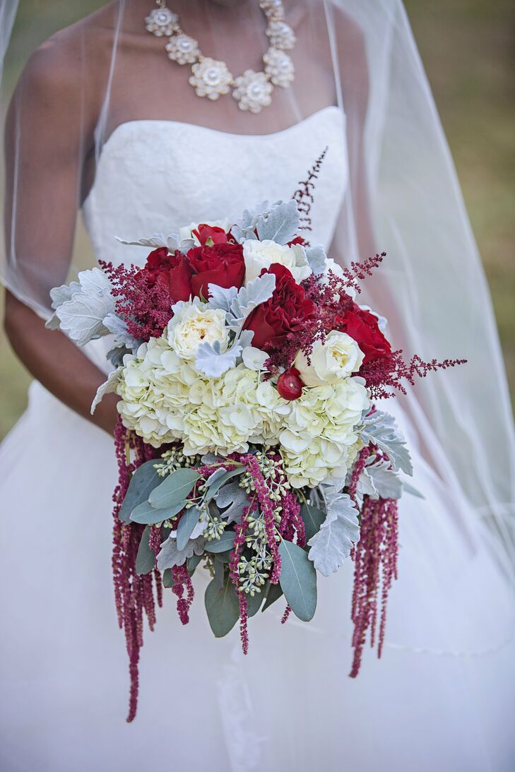 Red David Austin roses, ranunculus, astilbe and hanging amaranthus came together with ivory garden roses and hydrangeas to create a beautifully textured bouquet.
