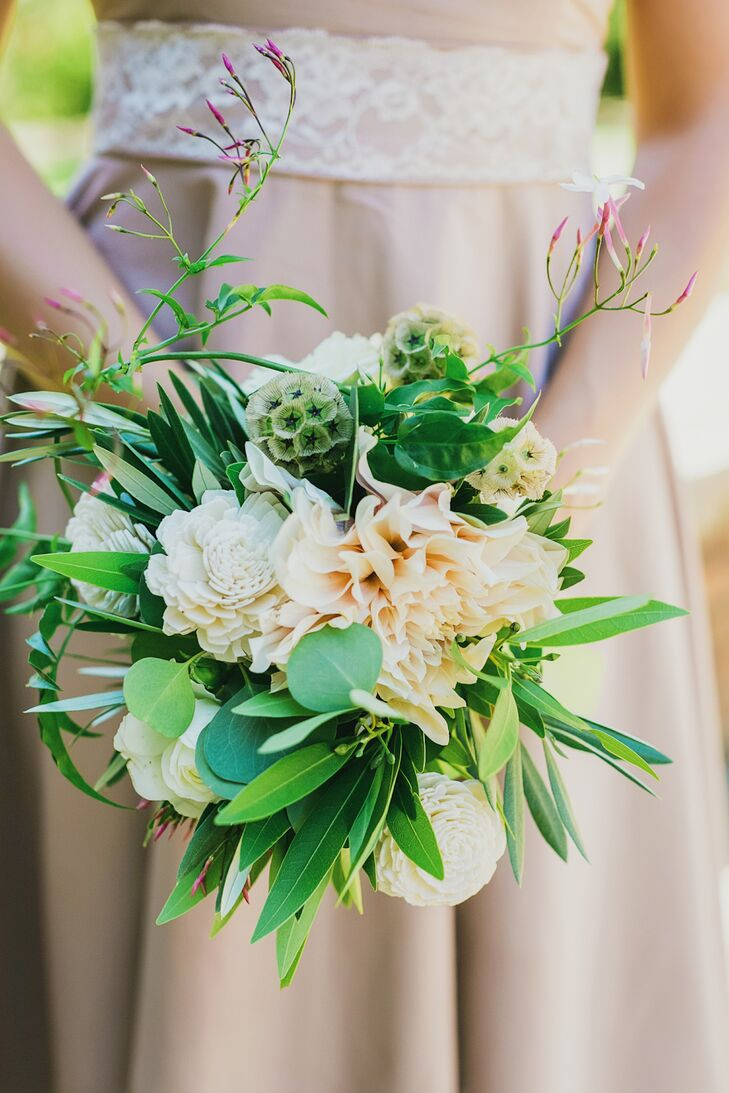 "Each of Emily's six bridesmaids held greenery-rich bouquets made with passionflowers, olive, eucalyptus, garden roses, balsa wood flowers and scabiosa pods. For an added personal touch, ""a green ribbon with each bridesmaid's name written in calligraphy"" and tied around the bouquet."