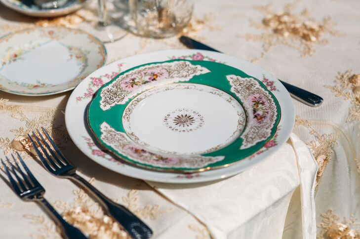 """Antique green and white chinaware set at each seat contributed to the """"shabby-chic tea party"""" atmosphere that Monique and Shade had imagined for their wedding day at Rancho San Antonio in Santa Ynez Valley, California."""