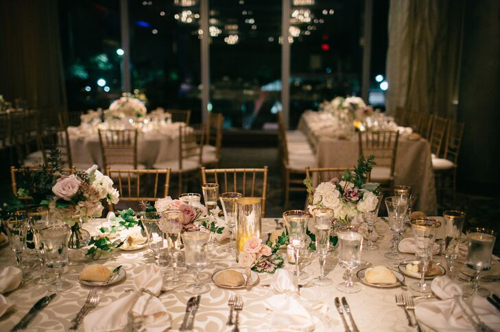 The reception tables were decorated with patterned beige linens for an elegant look. They topped the tables with mercury-glass votives and small arrangements of blush and ivory roses for a romantic flair that filled the room.