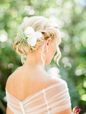 Elegant Bridal Updo with Flower Accents