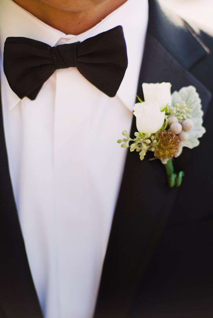 Reno wore a white rose boutonniere with scabiosa pods, silver brunia and dusty miller, which went well with his black Ralph Lauren tuxedo and bow tie.