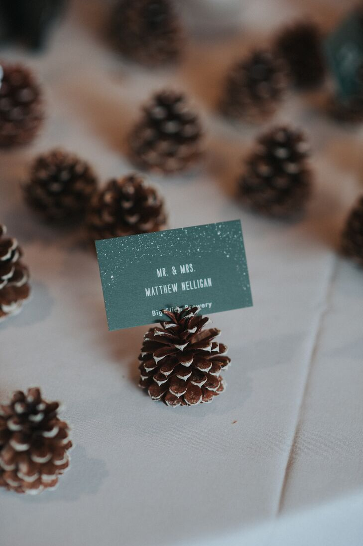 Tiny pine cones served as place card holders at the indoor reception at Whiteface Club & Resort.