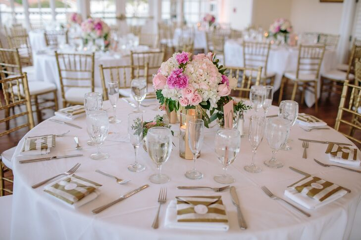 """Each place setting included a chocolate chip cookie favor, wrapped in a gold and white envelope bag with a """"love is sweet"""" sticker."""