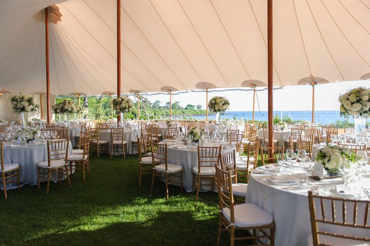 "The reception was in a large tent overlooking ""clam flats."" The decor was mostly white, with white tablecloths, napkins, seat coverings and alternating high and low floral centerpieces. ""I wanted a very fresh look, since I knew the backdrop of the sea would be the main event,"" Sarah says. ""So I wanted something that would highlight, not take away from, the breathtaking view."""