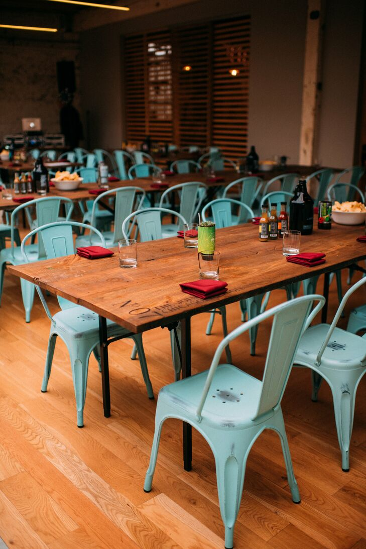 Simple Wood Tables Decorated with Brewery Items and Blue Bistro Chairs