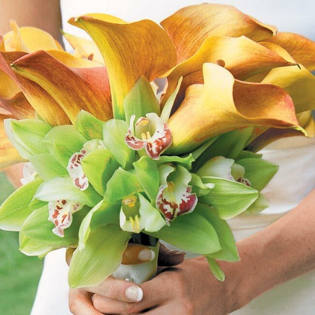 Diane's bouquet was a bundle of mango calla lilies (for the clean, elegant lines) surrounded by a ring of green orchids (because her father grows orchids) and wrapped with a white satin ribbon.