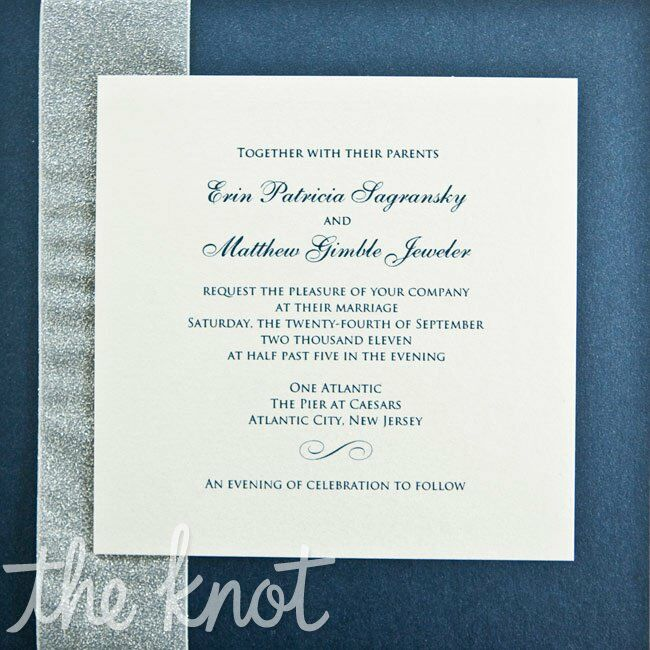 Classic ivory invitations with a blue font were tied with a glittery ivory ribbon.