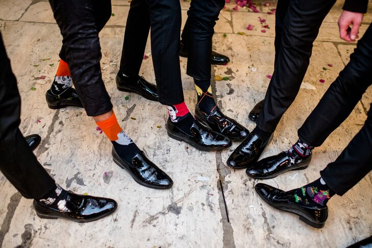 Under their patent leather slip-ons, each groomsman wore socks depicting different Halloween monsters.