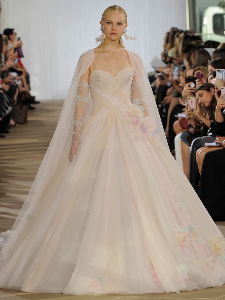 Ines Di Santo Fall 2019 draped tulle wedding dress with pastel panels, a fitted bodice and dramatic cape-train