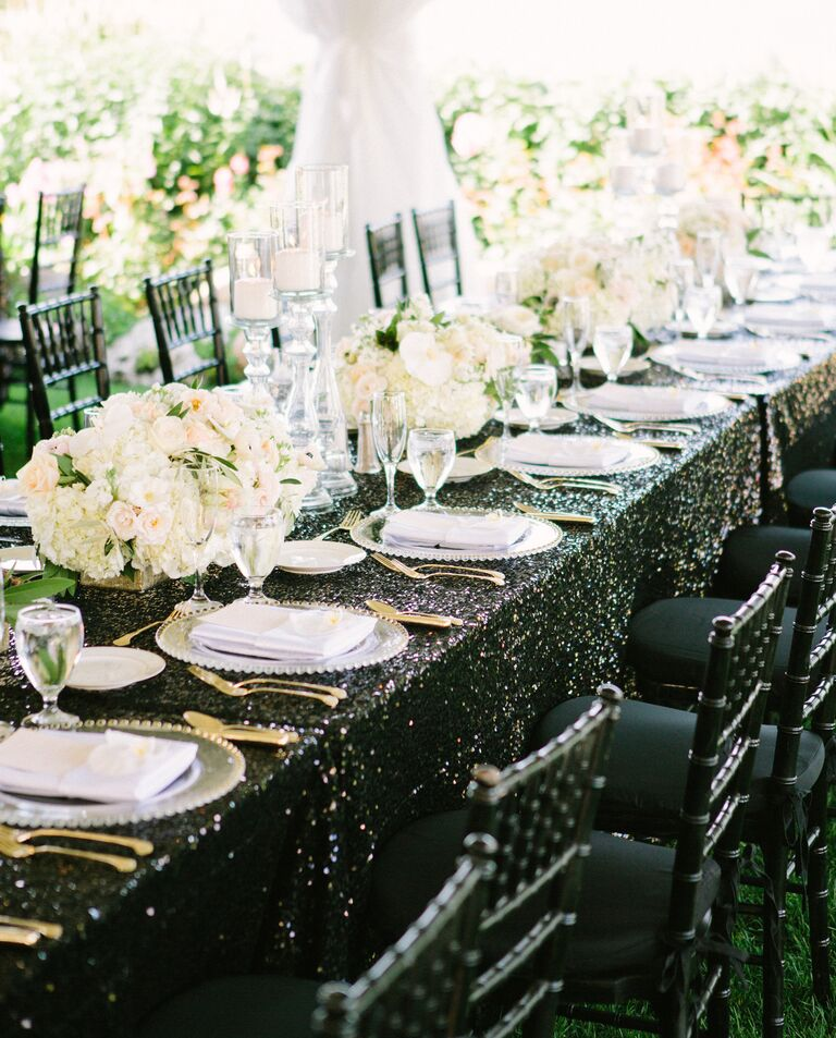 Black sequin reception tables in the summer