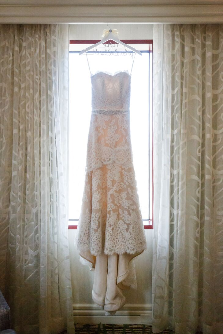 Lisa wore an elegant ivory Anne Barge wedding dress purchased from Nordstrom. The dress was intricately accented with lace and a crystal belt.