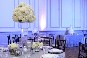 Round Tables with Tall Centerpieces and White Flower Arrangements