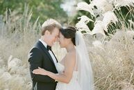 After a romantic first look in an ornamental grass garden, Ivy Lin and Michael Lersten met up with their bridal party for more photos. Ivy stunned in