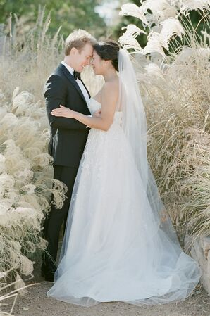 Classic Couple with A-line Wedding Dress and Black Tuxedo