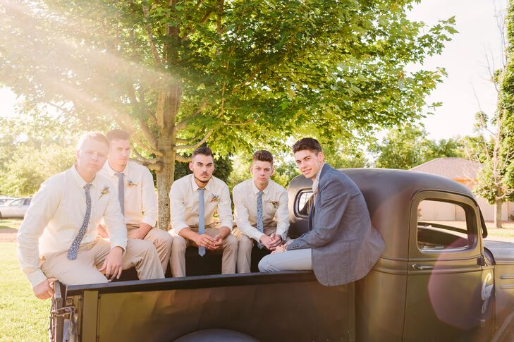 Carson and his groomsmen sat in the back of the black truck, rocking a casual look with a variety of patterned blue ties over ivory collared shirts. Carson stood out among the men with a charcoal gray suit jacket.
