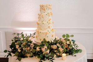 Orange-and-White Wedding Cake at the Royal Crest Room in St. Cloud, Florida