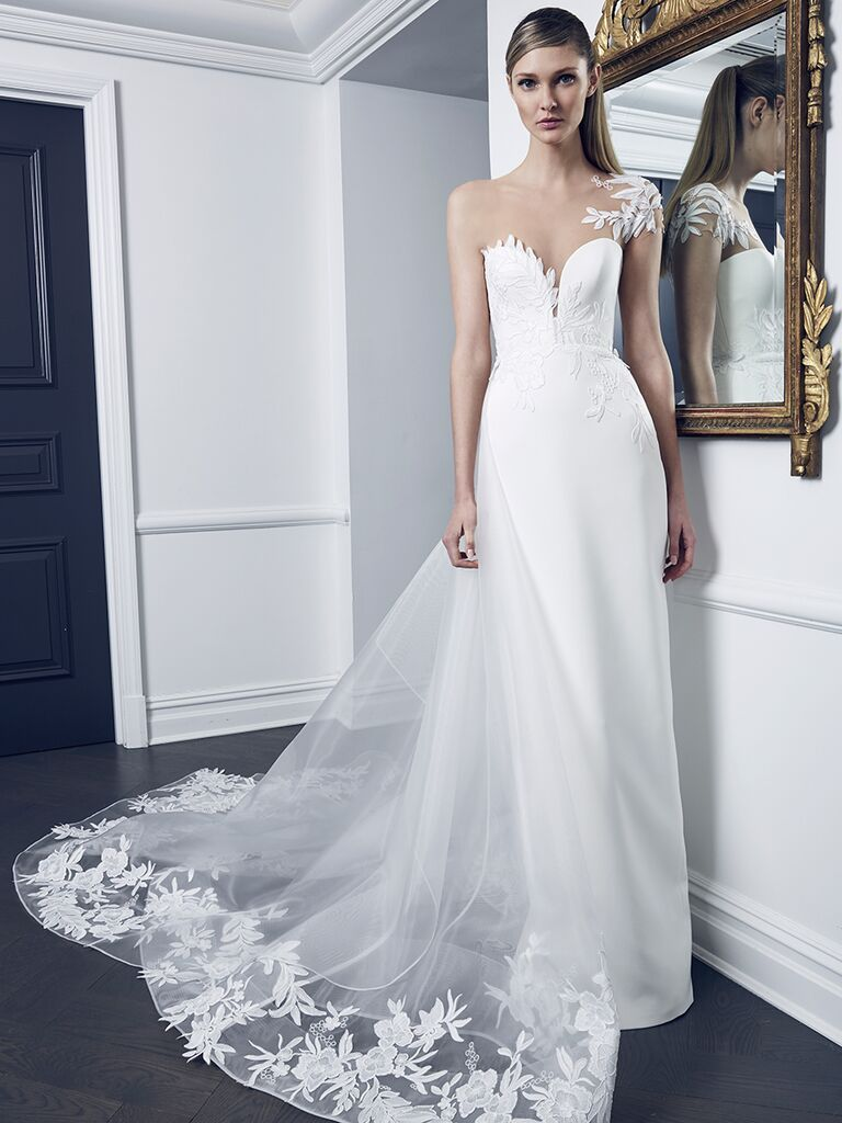 Romona Keveza Collection Fall 2018 wedding dress with a one-shoulder detail and embroidered lace train