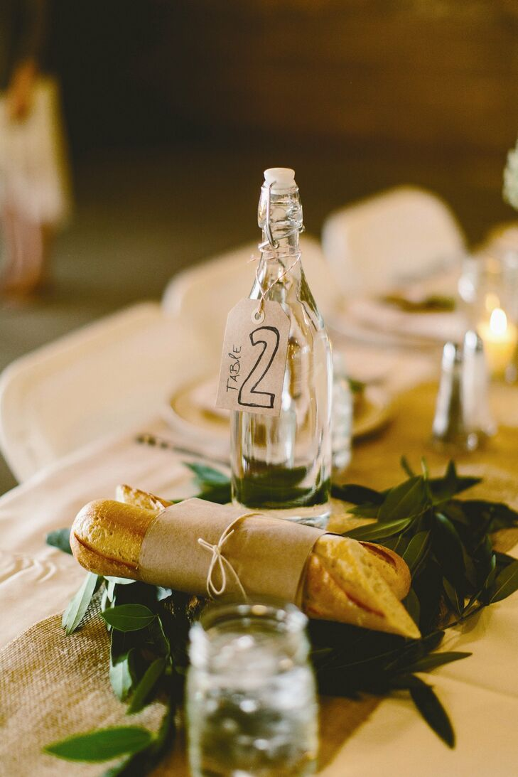 The table numbers were displayed on handmade tags attached to glass bottles.