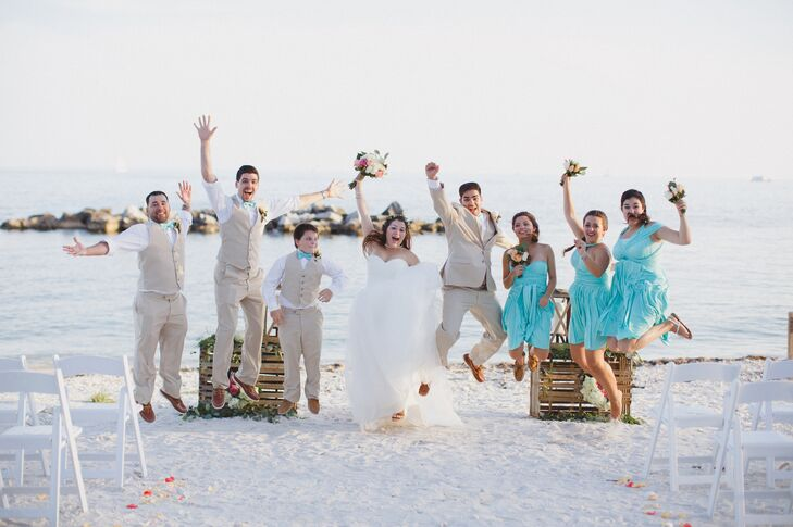 The groomsmen wore beige pants, vests, white dress shirts with the sleeves rolled up, sea-foam colored bow ties, and Sperry boat shoes of the same color leather as Jessica's sandals.