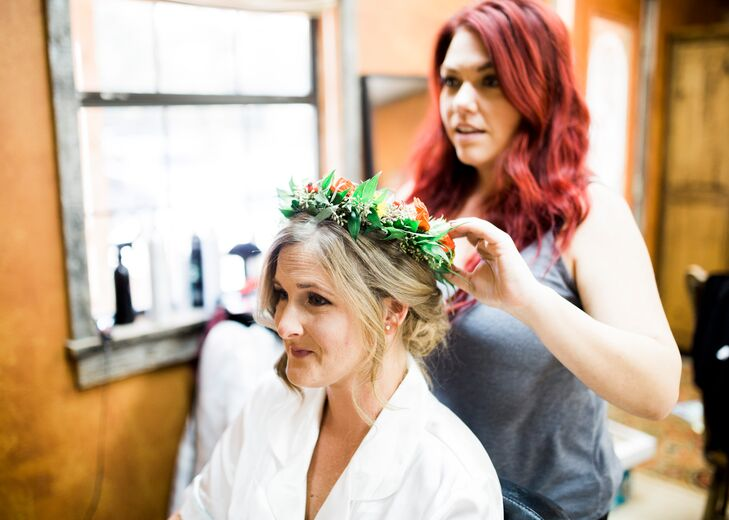 """I knew I wanted flower crowns for all my bridesmaids and myself,"" Jogee says. ""The crowns brightened the dark green dresses and gave us a less formal, more natural look and a bit of the boho vibe that I wanted."""