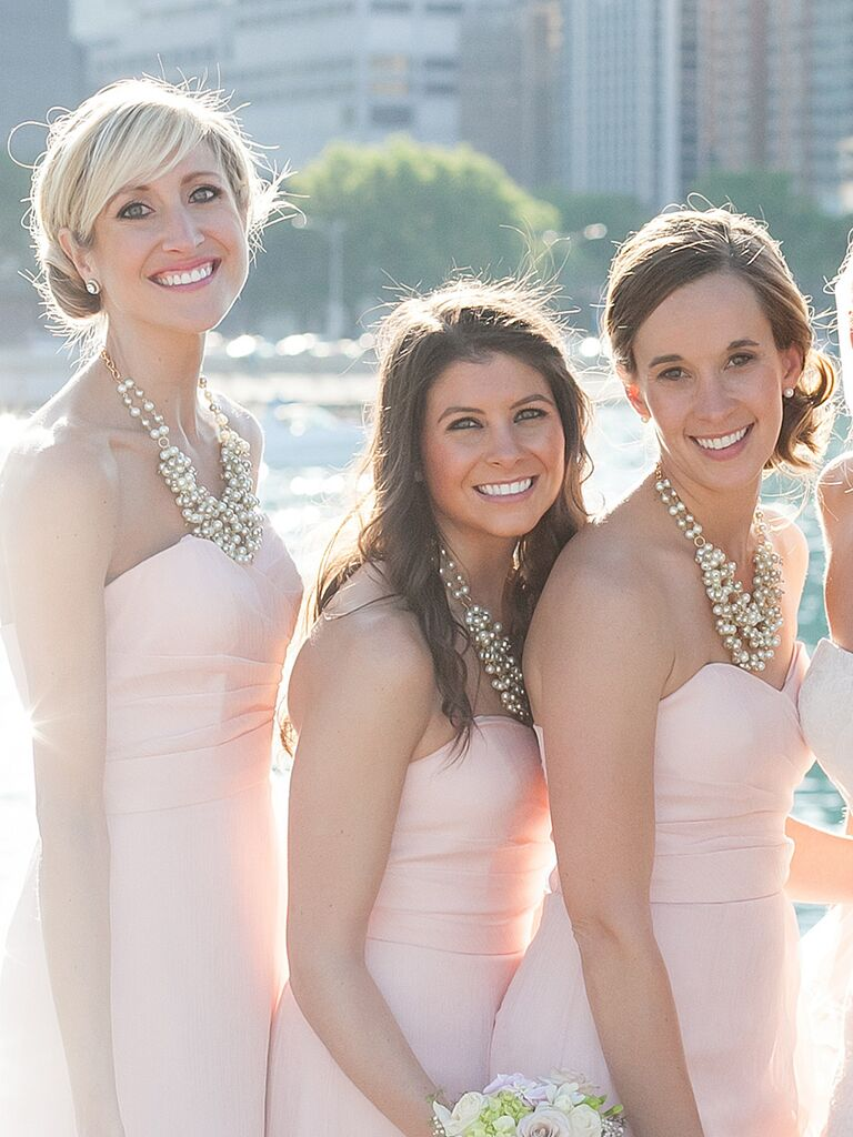 A relaxed low knot creates a soft and romantic bridesmaid look