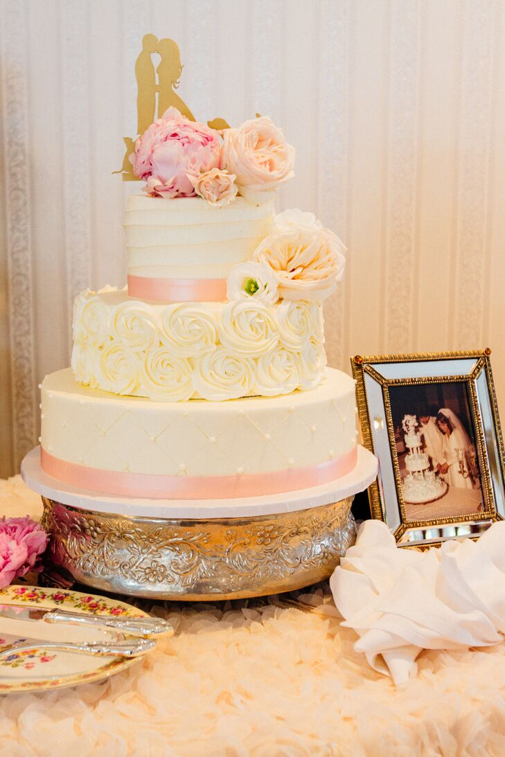 After dinner, the newlyweds and their guests indulged in cannoli cake and chocolate-covered strawberries. The three-tier confection was decorated with ivory buttercream frosting, buttercream rosettes, pink satin ribbon and fresh flowers for a sweet, playful look.