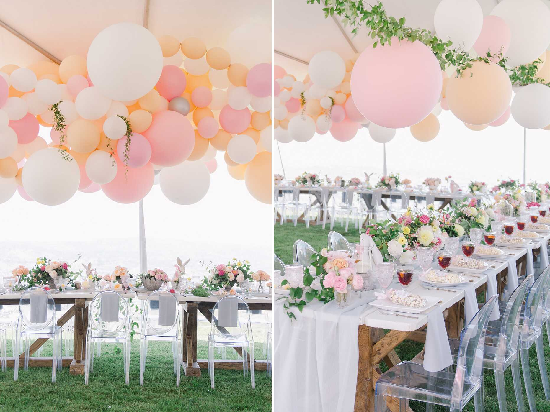 Pastel pink and white balloon garland hanging over long tables