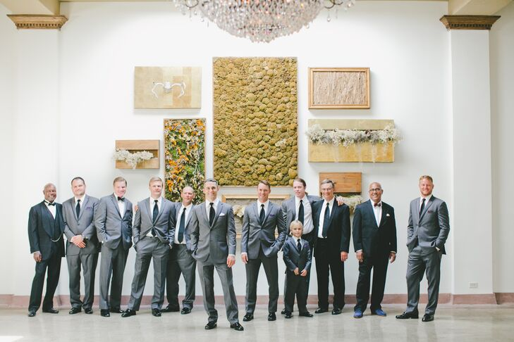 Groom and Groomsmen wore gray Vera Wang tuxes with black trim. Each also sported a lavender pocket square.