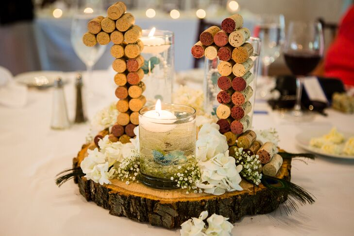 Alison and her bridesmaids created the table numbers out of wine corks and sat them on wooden slabs they received from a friend.