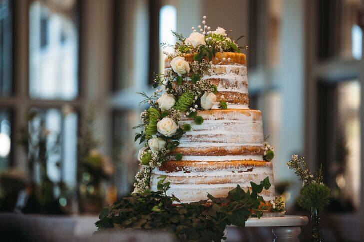 Round Naked Cake Topped with Greenery and Wildflowers