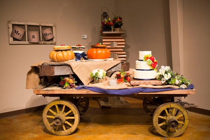 This took their theme to a new level. Their three-tier cake and a few pies were placed on this long wooden cart covered with burlap, greenery and pumpkins.
