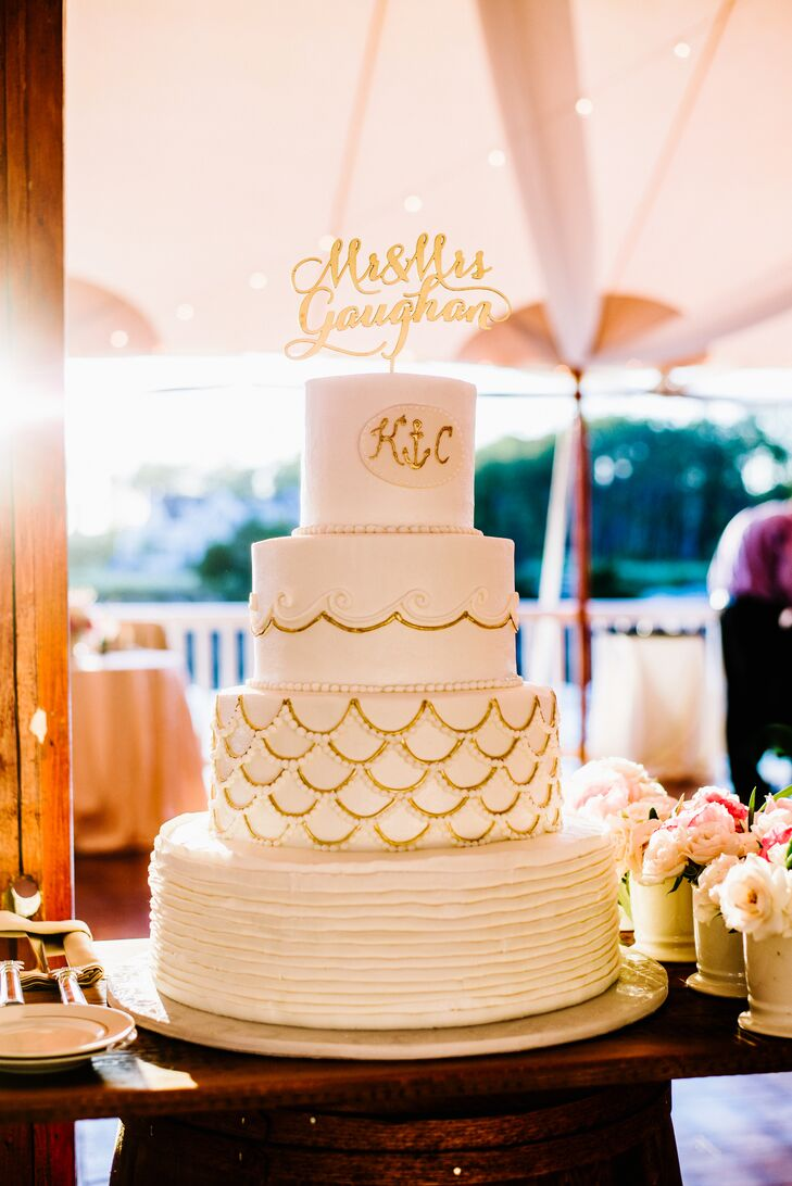 The four tier white cake had gold accents on the layers as well as a gold script cake topper.