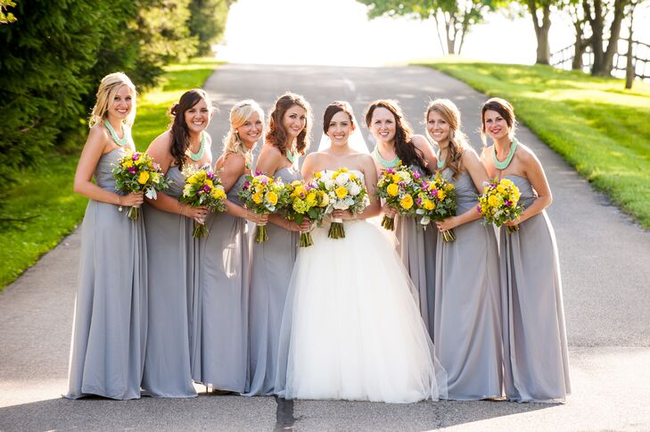 Haley stood in the middle of her bridesmaids, who wore floor-length strapless dresses in heather gray. Each of the women had matching turquoise statement necklaces that added a nice pop of color.
