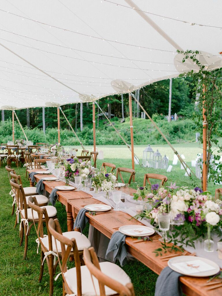 Outdoor summer wedding tent with string lights