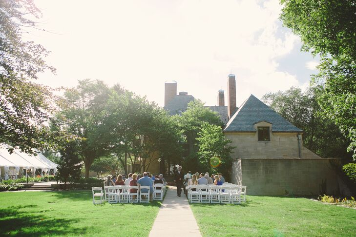 """The couple exchanged vows on the campus of Concordia University at the Earhart Manor. """"The space was so intimate and had the vintage, garden-like feel we were going for,"""" the bride explains. """"It was super-cozy and majestic at the same time."""""""