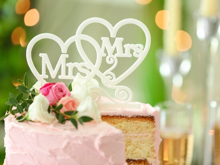 Mrs. and Mrs. cake topper on wedding cake