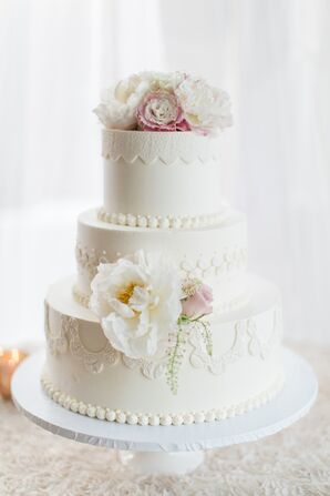 Wedding Cake With Floral and Fabric Details