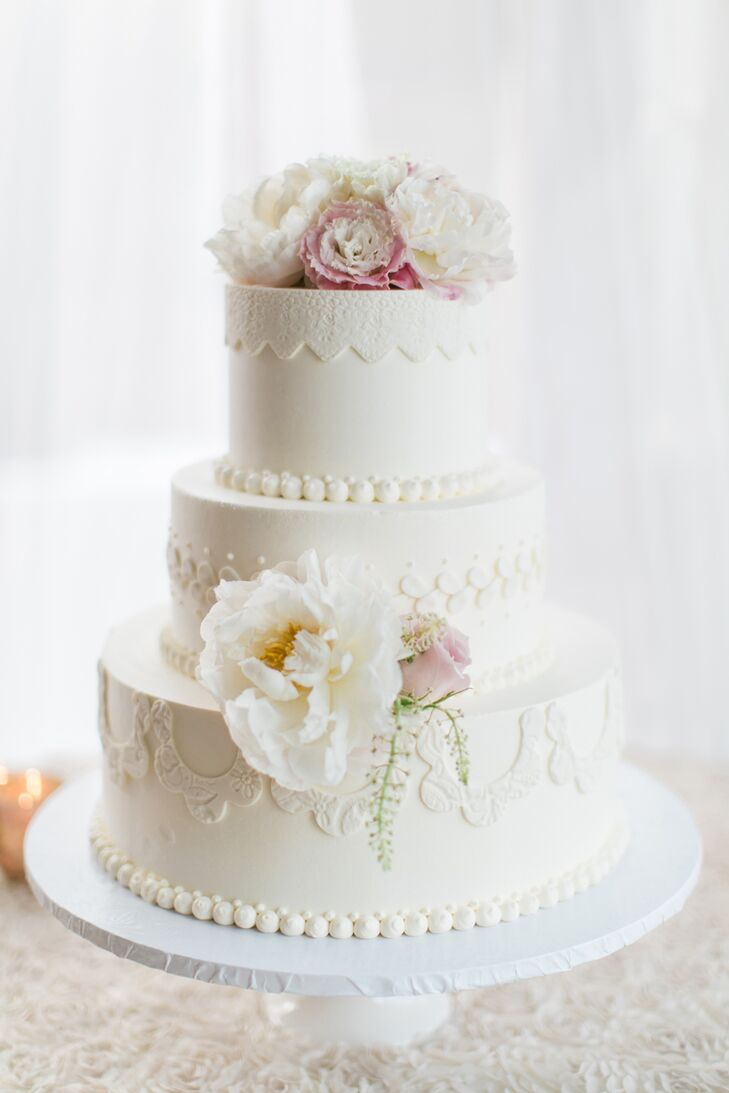 Bree and Greg's three-tier cake from Cake bakery in San Diego, California, boasted intricate, fabric-like details that spoke to the day's polished, intimate aesthetic.