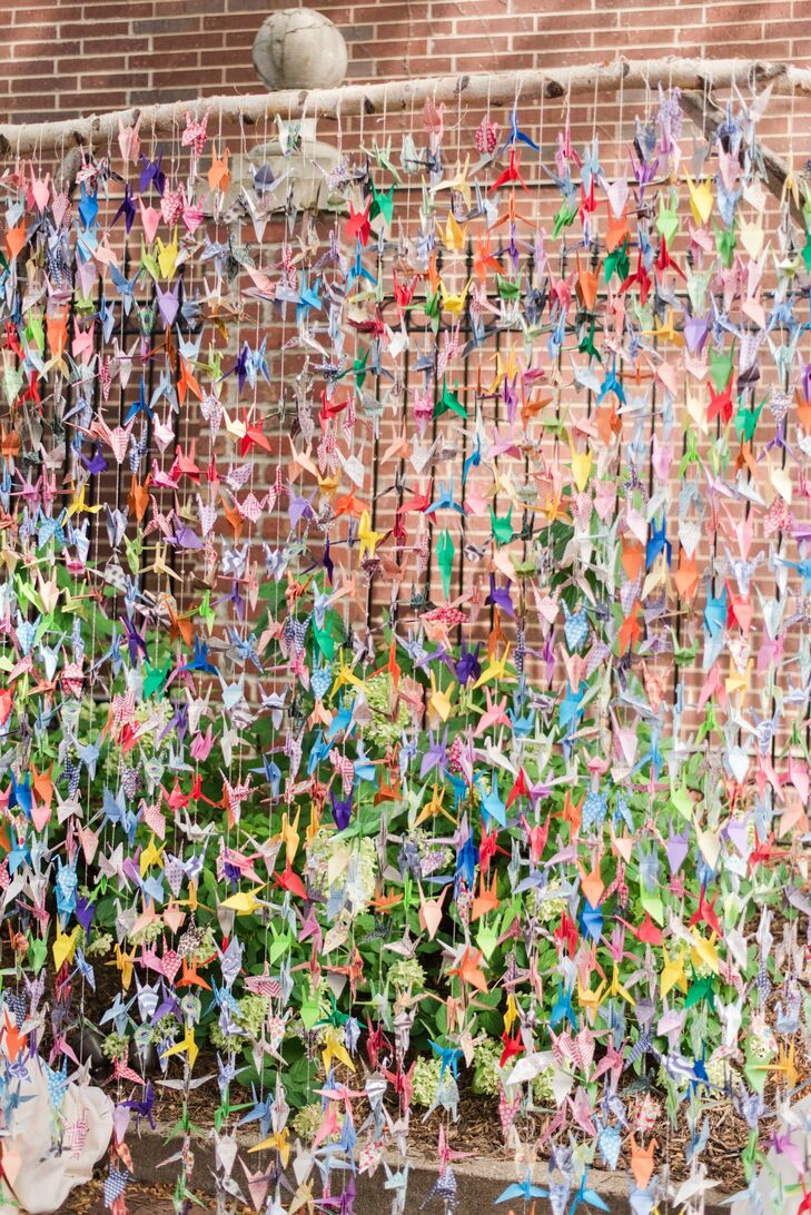 It took Sally two years to fold 2,300 paper cranes, resulting in a colorful, affordable backdrop for the celebration.