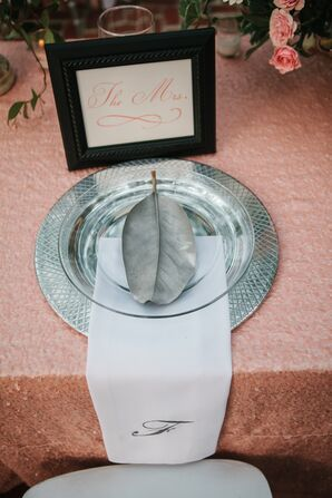 Silver Chargers with Glass Plates and Custom Napkins