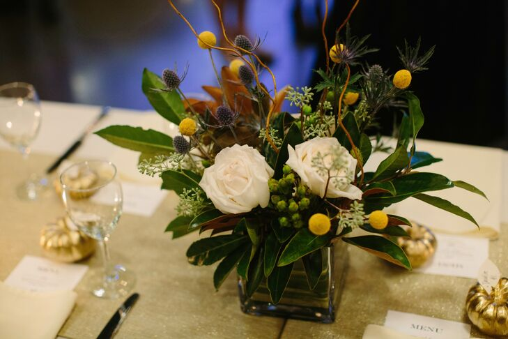 While the wedding party's green and navy attire added color to the ceremony, billy balls were the main source of color among the white and natural-wood reception decor.