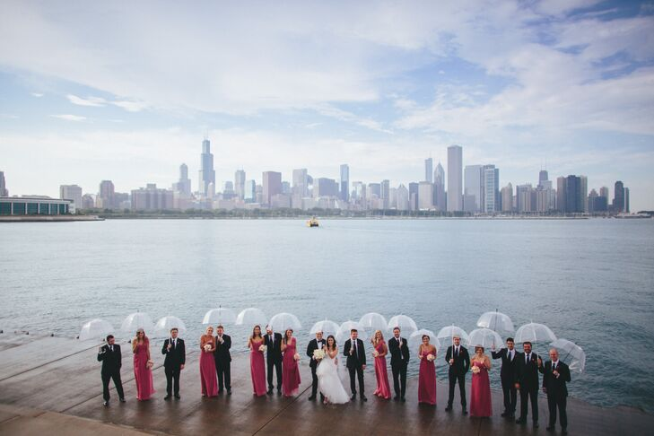 """Despite an impromptu rain shower, the couple and their wedding party completed their first look and photo shoot prior to the start of the ceremony. """"We didn't want to miss any of the party!"""" Liz explains."""