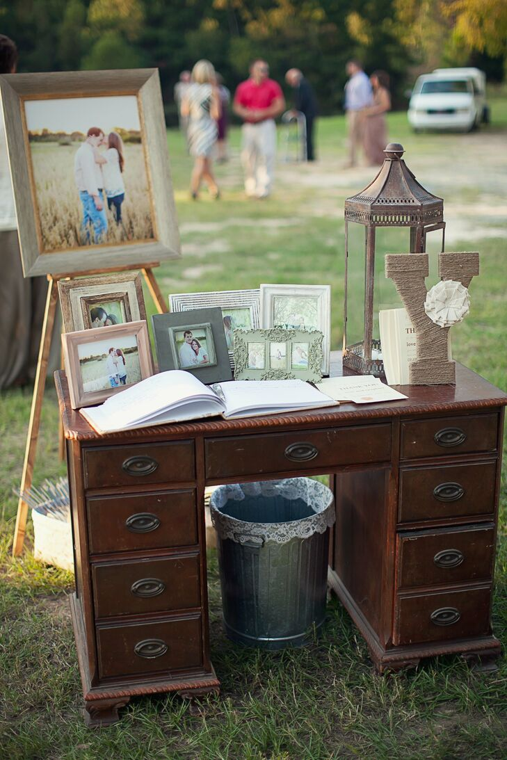 The guestbook was displayed on an antique desk covered with photos of the newly weds and a few rustic details like a twine Y for the couple's last name.