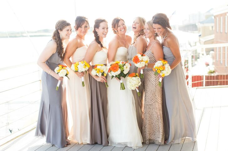 The bridesmaids wore different floor length dresses in a variety of neutral tones.