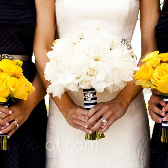 Adrienne held an all-white bunch of peonies, mini calla lilies and roses, and the bridesmaids carried smaller, all-yellow nosegays of calla lilies and roses.