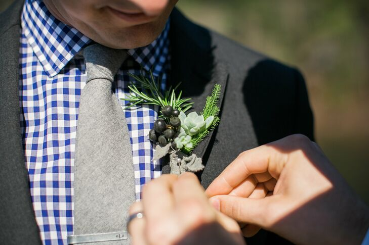 Keith's boutonniere was made of rosemary, berries, succulents and twigs all wrapped in a gray burlap fabric.
