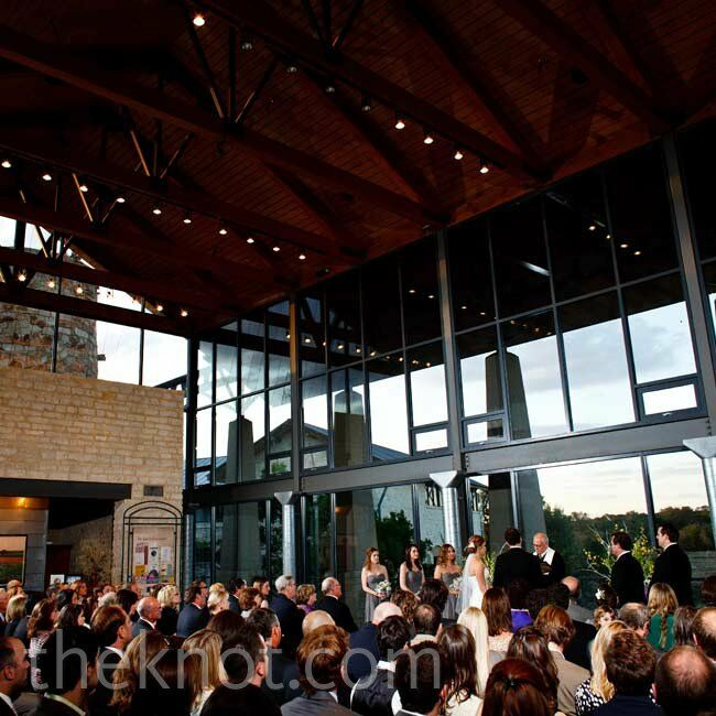 A wall of windows created a modern backdrop for the couple's vow exchange.